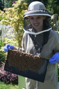 Kelsey with a frame of bees and brood