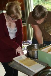 Anita and Garrett harvesting honey